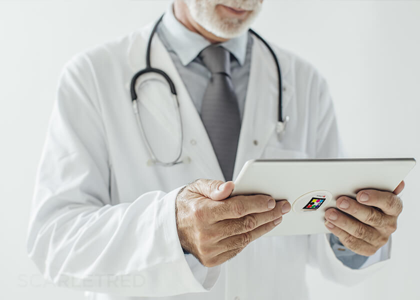 Male doctor holding tablet with Scarletred Skinpatch