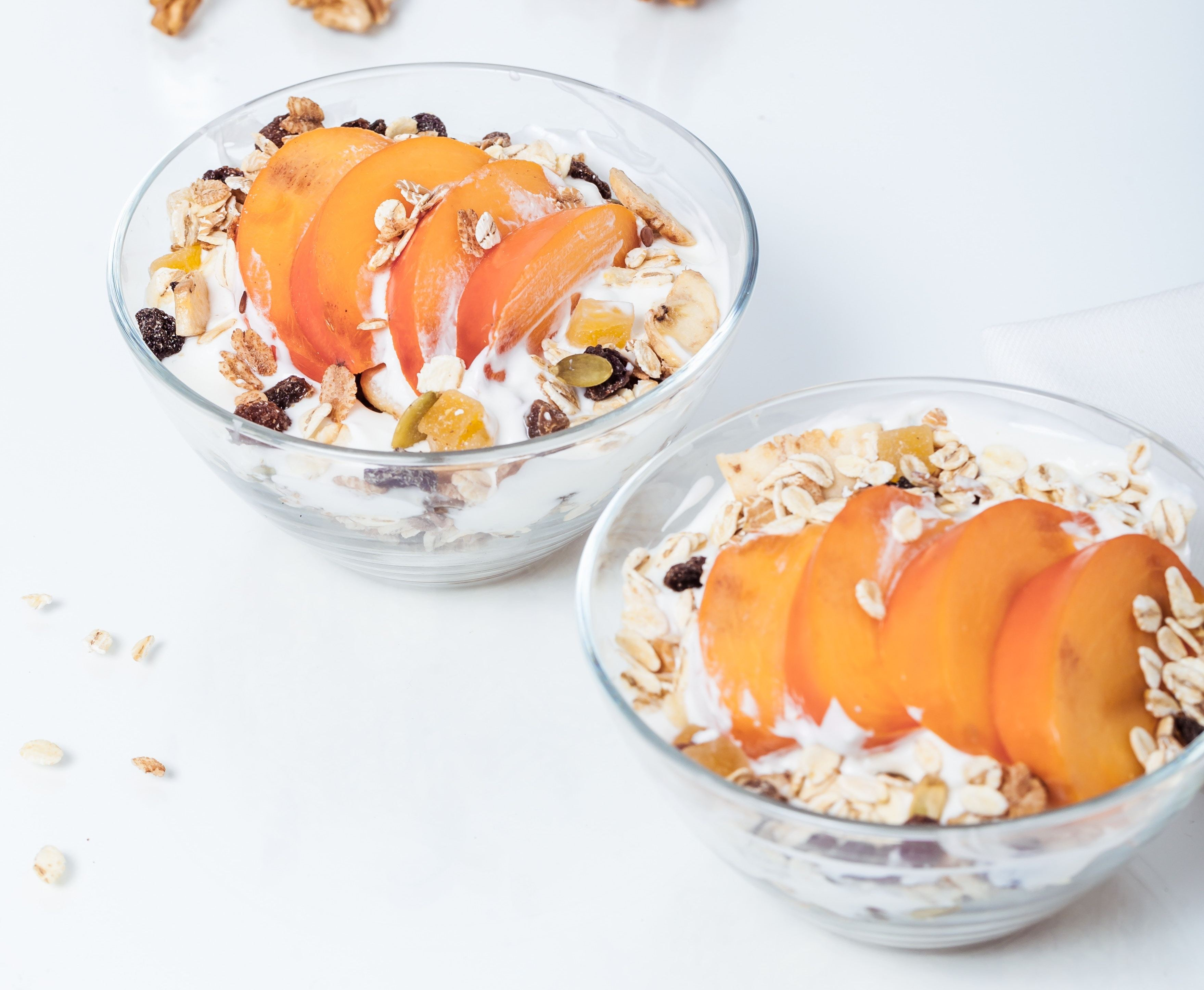 Yogurt and peaches in small breakfast bowls