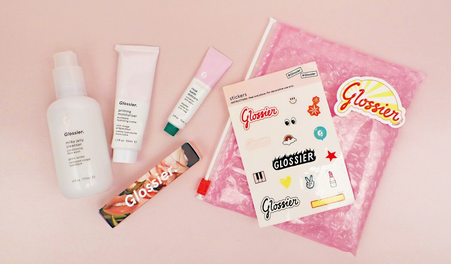 Glossier unboxing experience is fully branded and includes little gifts that feel special + relevant to the target consumer.  Source: Peppermintheart.com