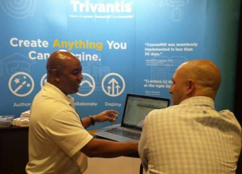 Product Manager Daryl Fleary showing a DevLearn attendee the new Lectora 17