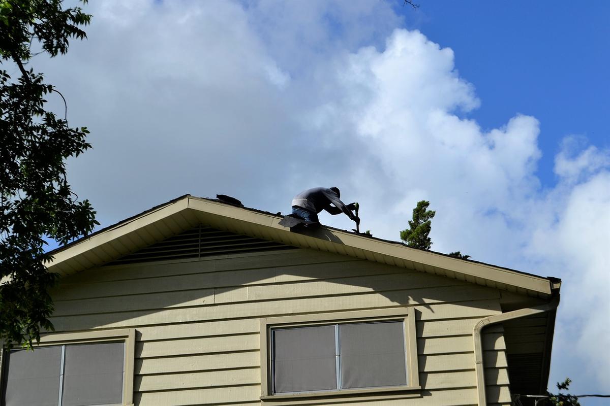 roof repair man on house