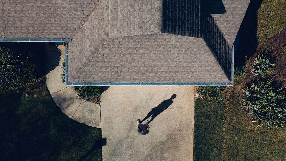 roofing red flags rooftop man shadow