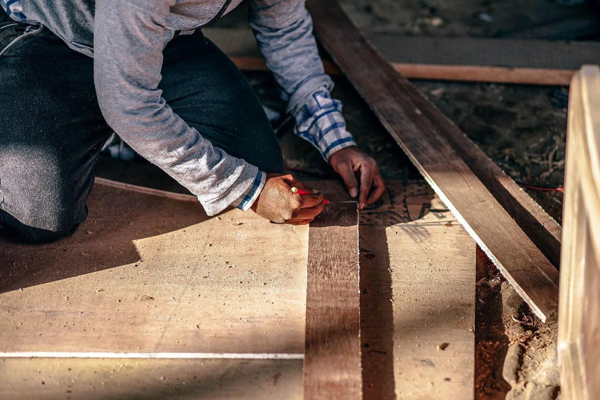 roofing red flags measuring wood