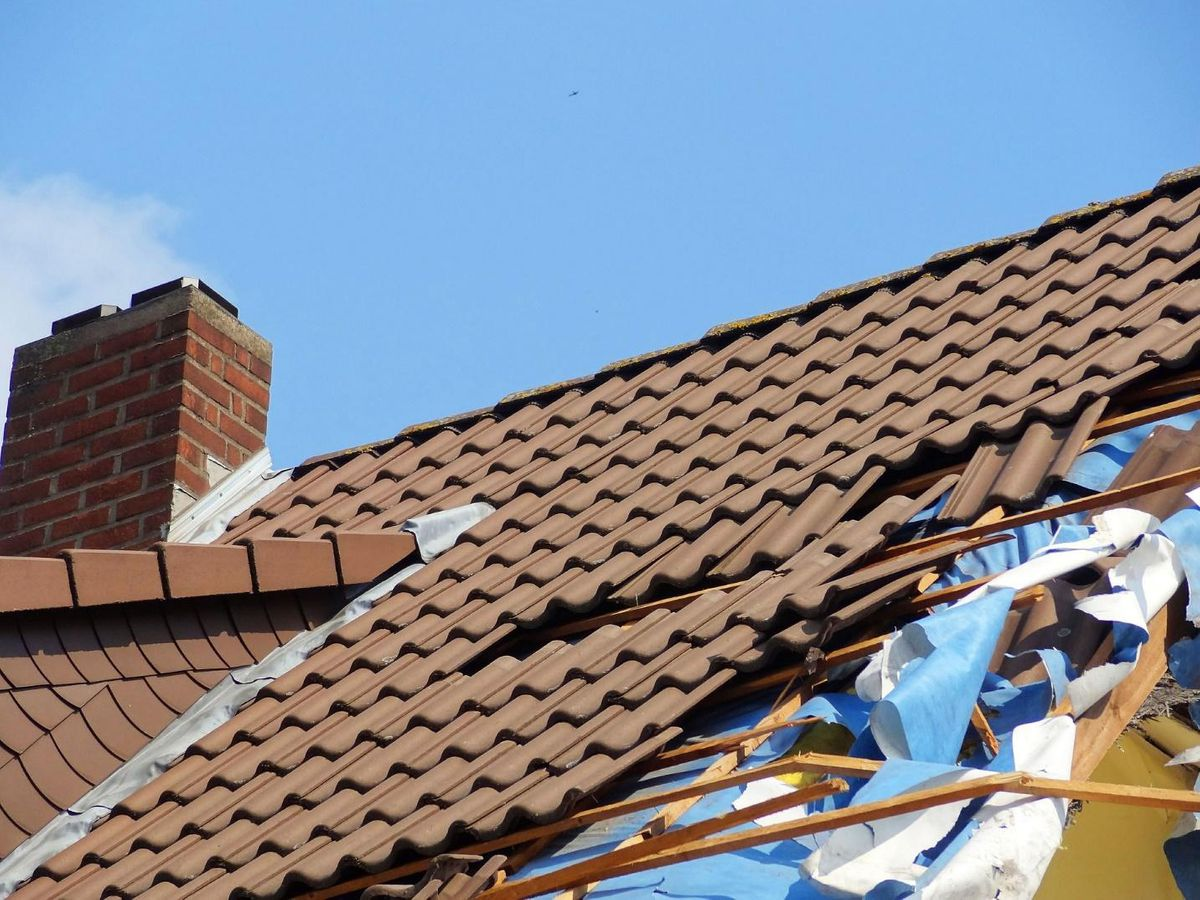 roofing insurance damaged clay roof
