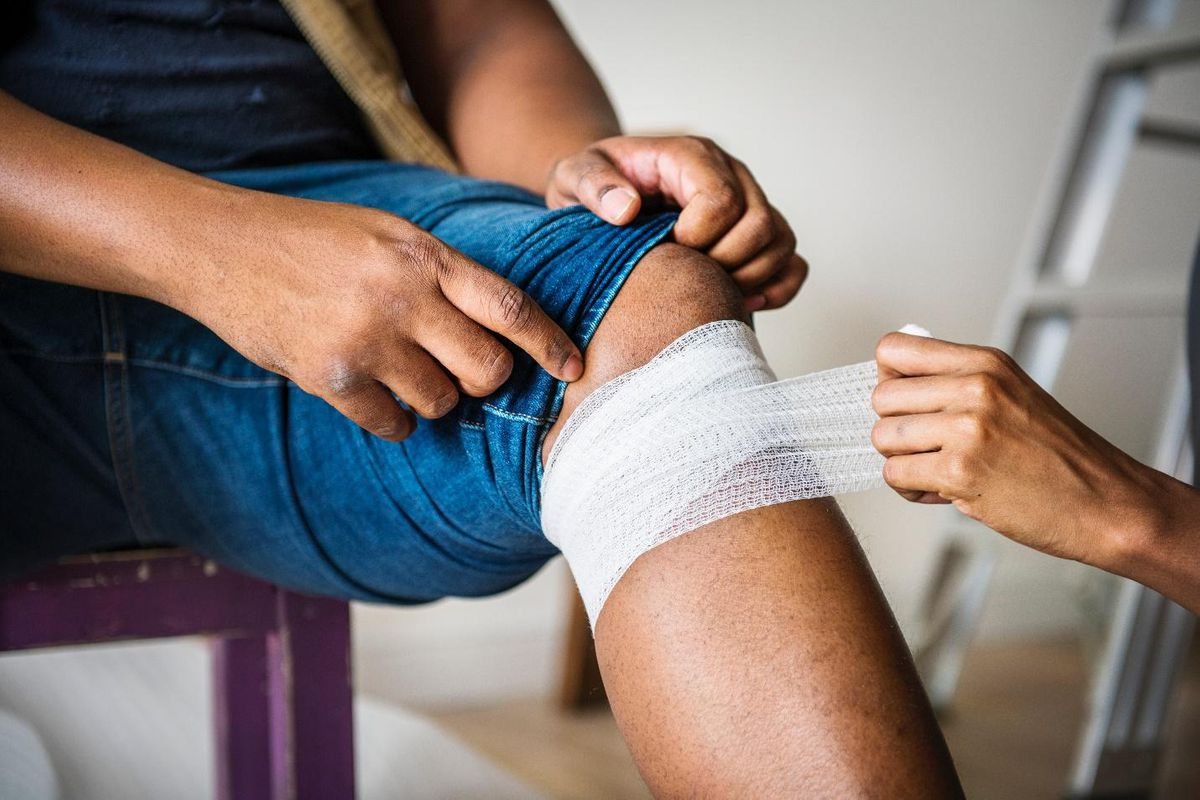 roofing insurance bandaging a knee
