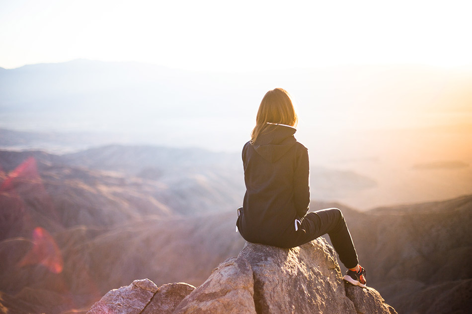 a-woman-looking-out-onto-the-horizon