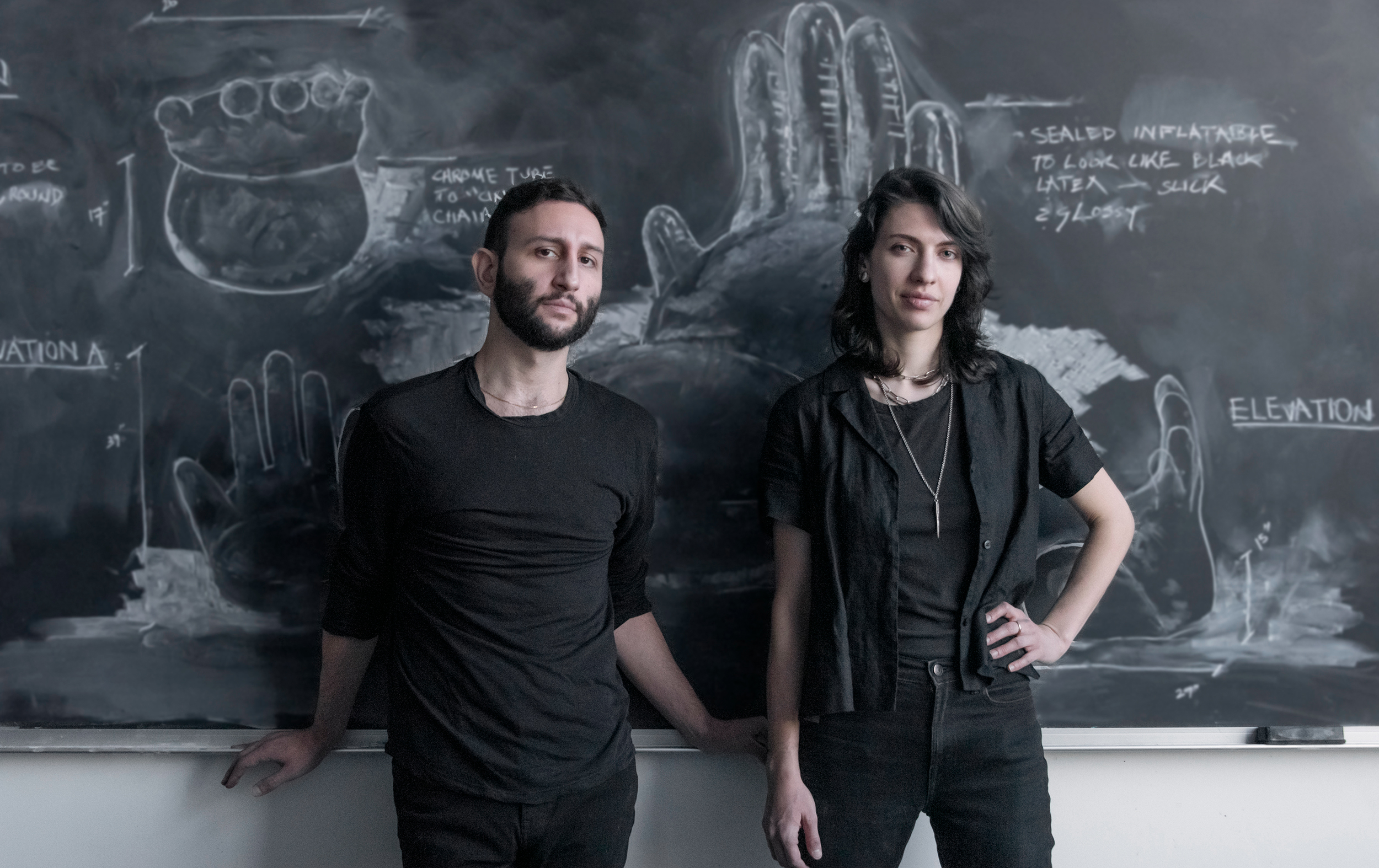 Jeremy Silberberg and Erica Sellers pose in front of their interior designs