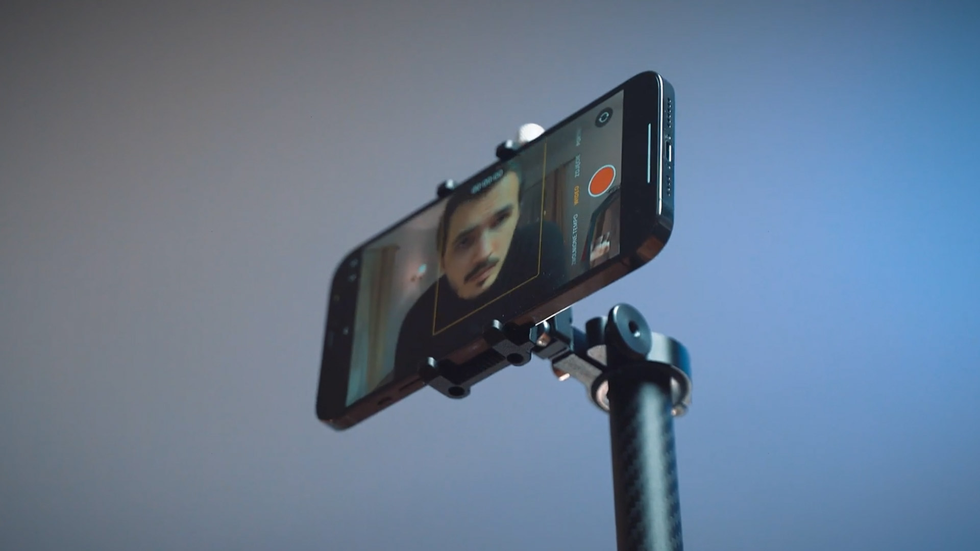 Man taking a selfie using Billy, the camera bot.