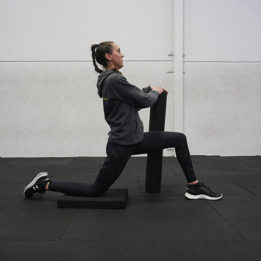 The kneeling hip flexor stretch done poorly. Core relaxed, lower back arched, hips pushed too far fowards
