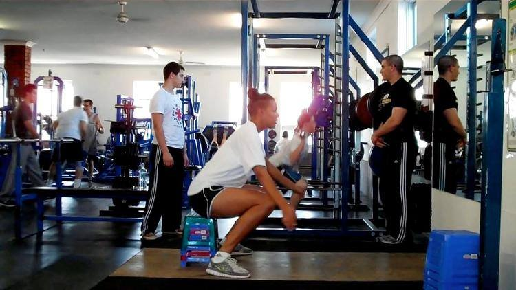 Liz Cambage executing a perfect ROM squat. The ROM squat is great for court sports (basketball, netball, tennis, squash, badminton) for helping an athlete get stronger and more comfortable in a low athletic stance. NB - We don't load the ROM squat, instead we progres reps and range.