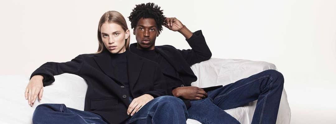 Zara clothing models wearing black blazers over a black tshirt and jeans