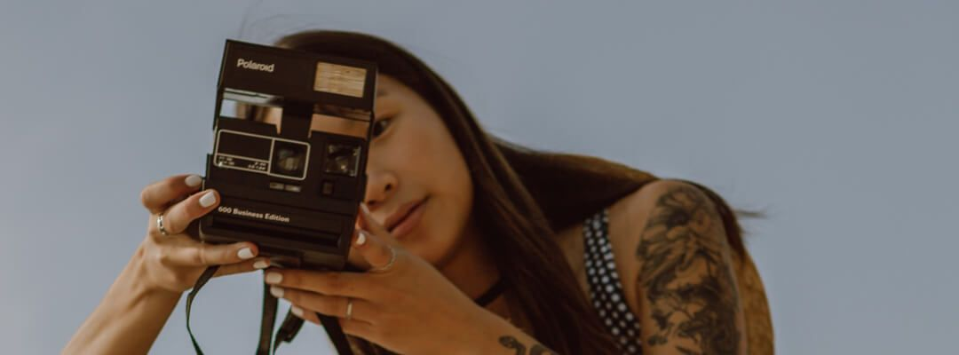 Person taking a poloroid picture