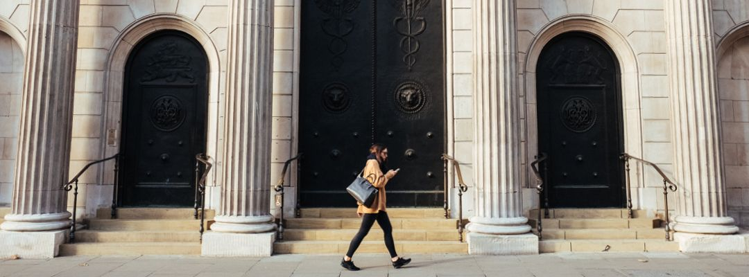 Woman walking past the Bank of England