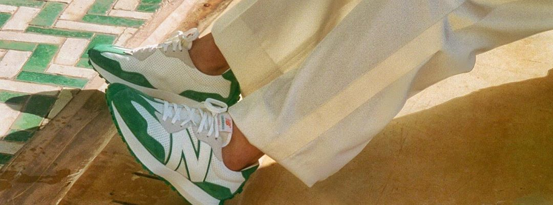 White and green New Balance sneakers