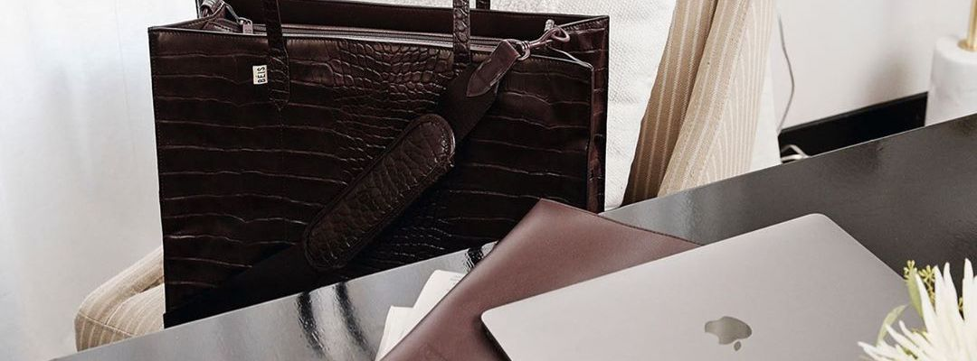 Dark brown leather briefcase and MacBook laptop