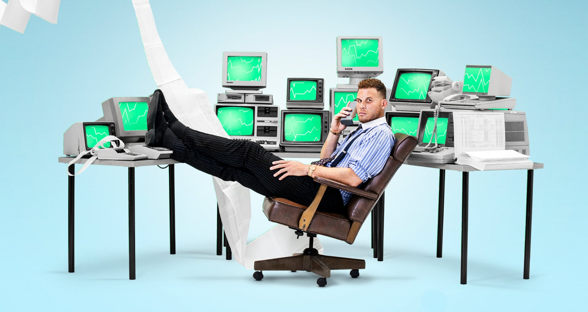 Blake Griffin sitting in a chair with many monitors behind him