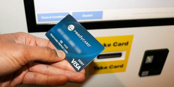 Taking prepaid card from kiosk