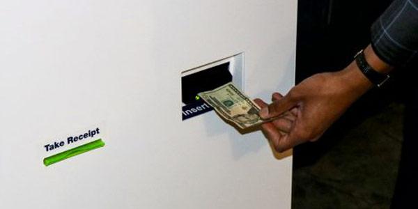 Inserting cash in kiosk