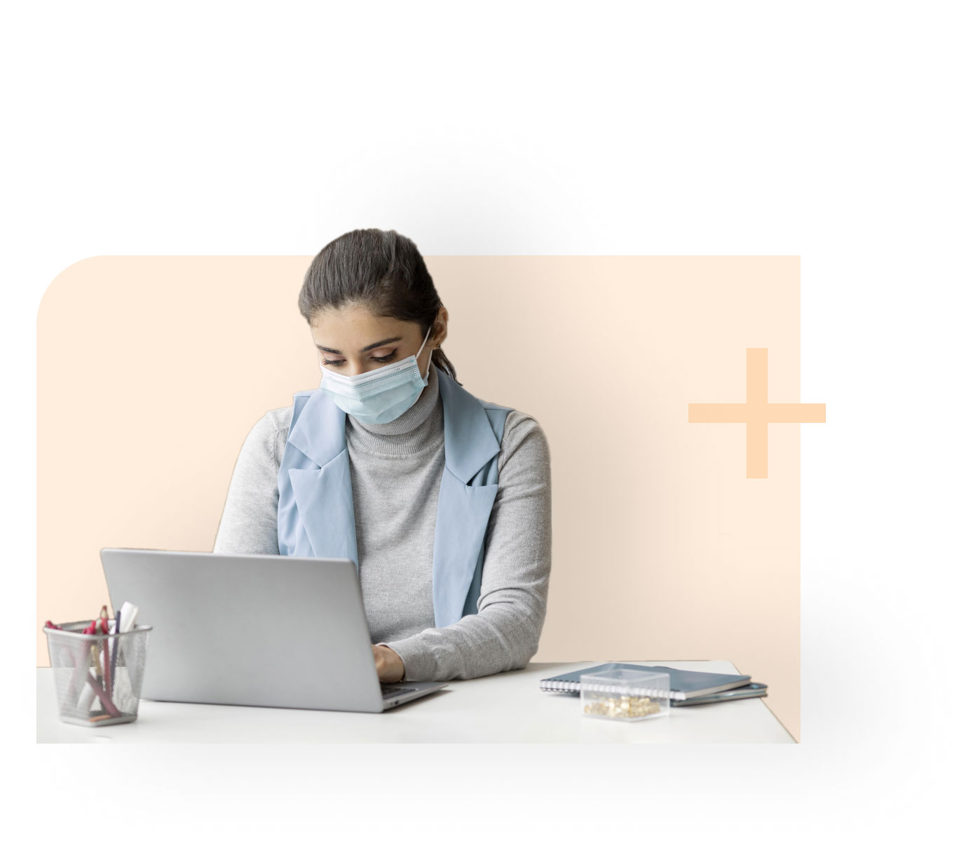 Healthcare professional working on computer