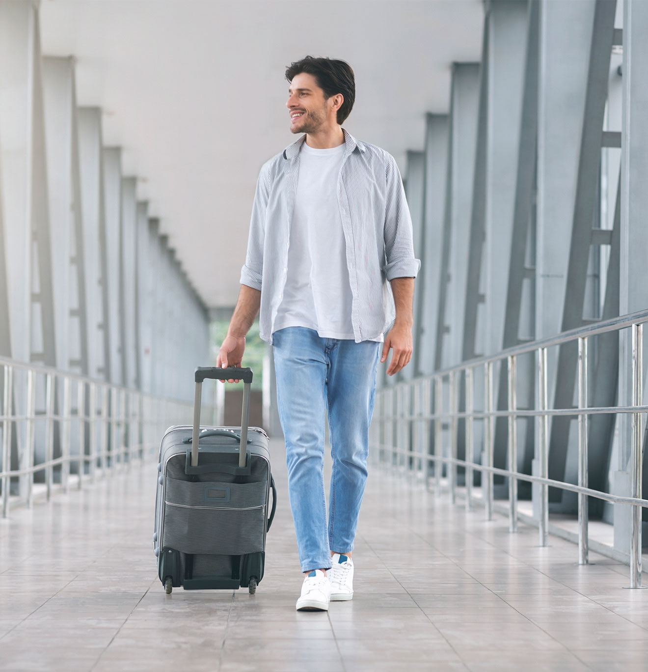 Man walks through airport after getting a covid-19 test