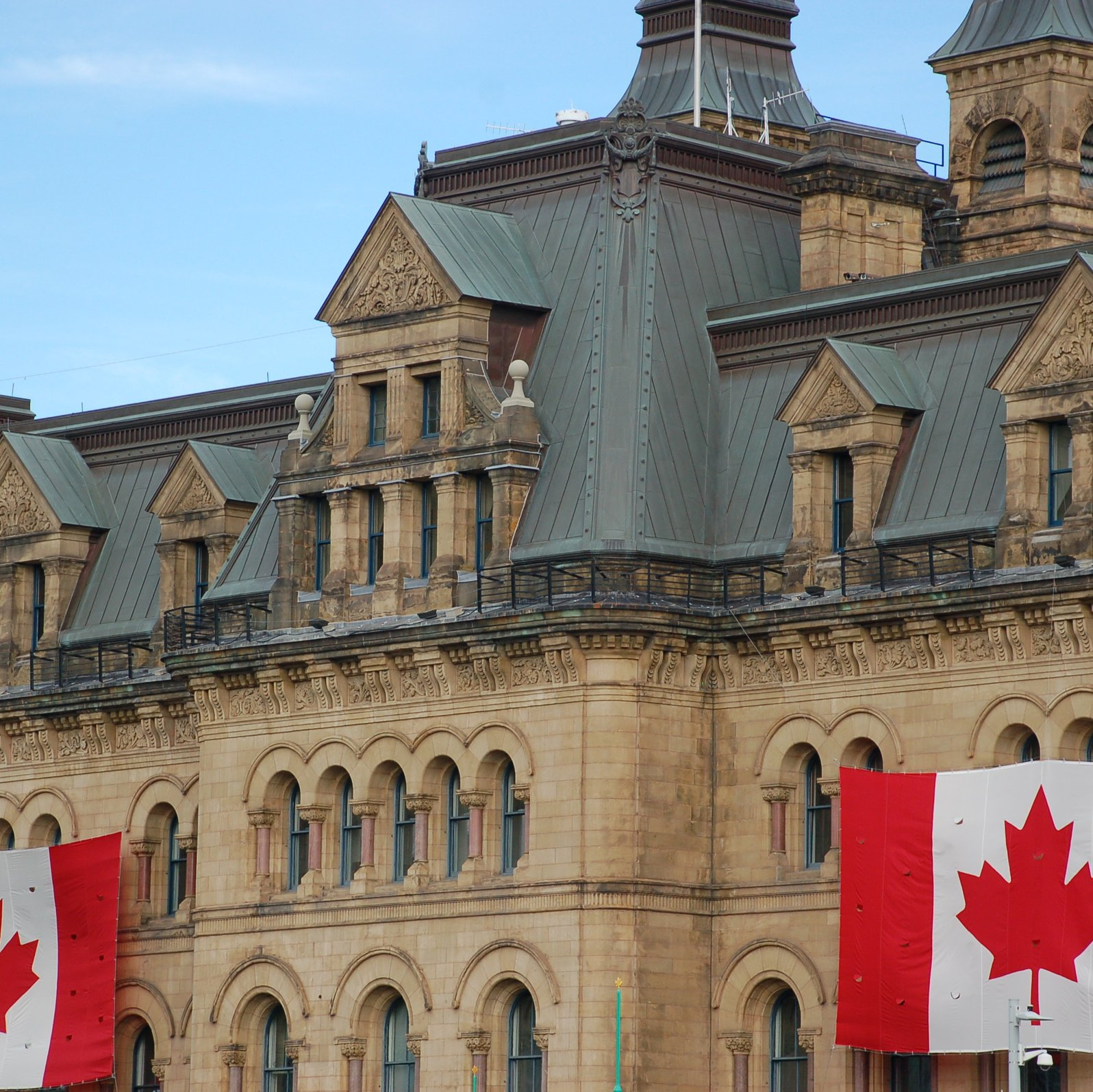 Canada flags hanging on concrete castle wall