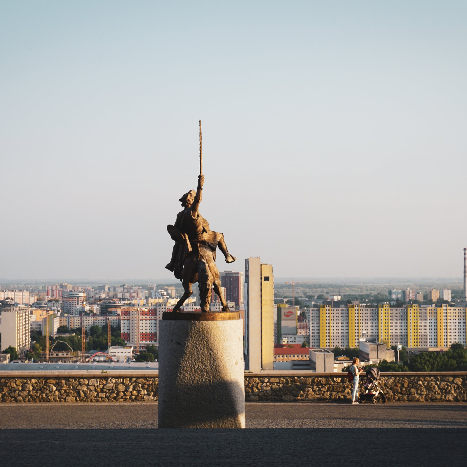 brown statue of man holding sword