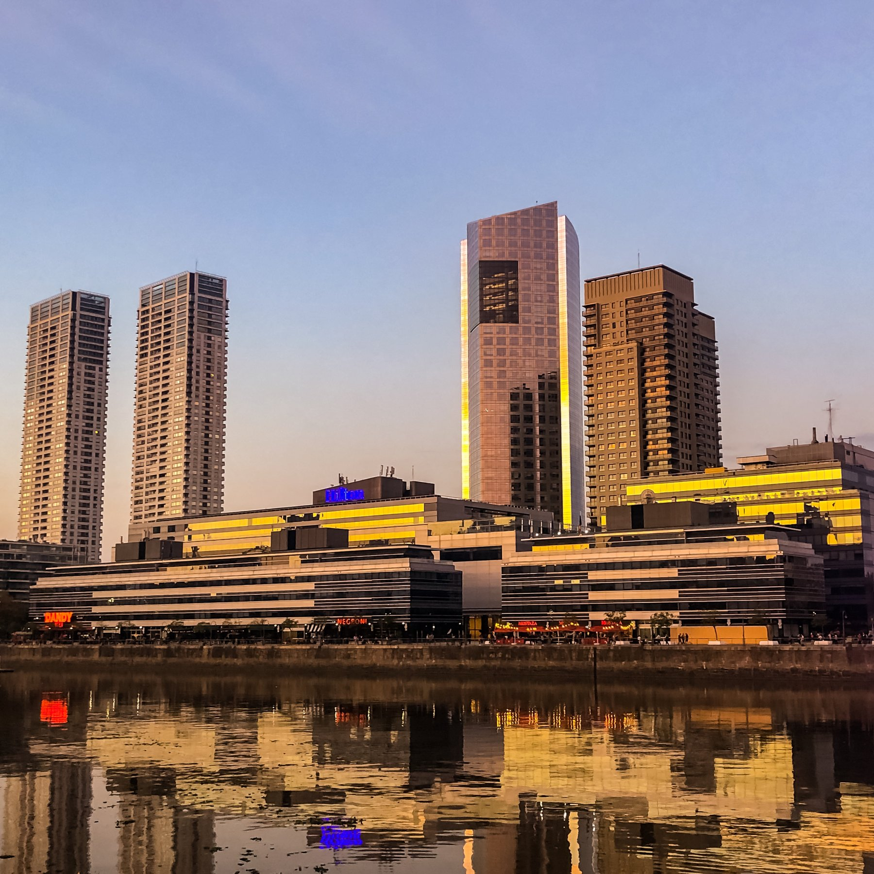 city buildings near body of water during daytime