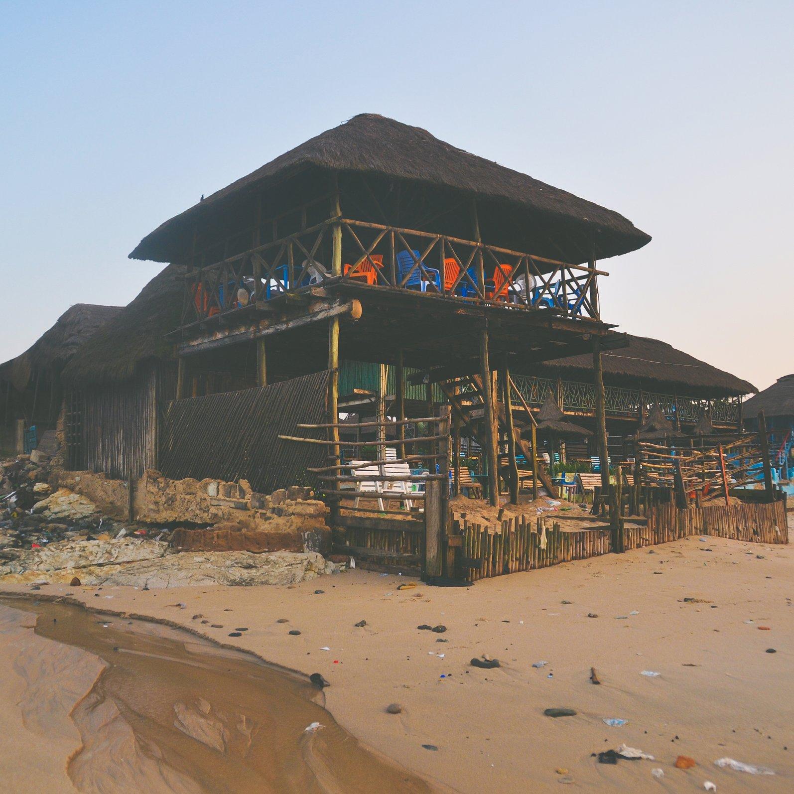 gray 2-story hut on seashore