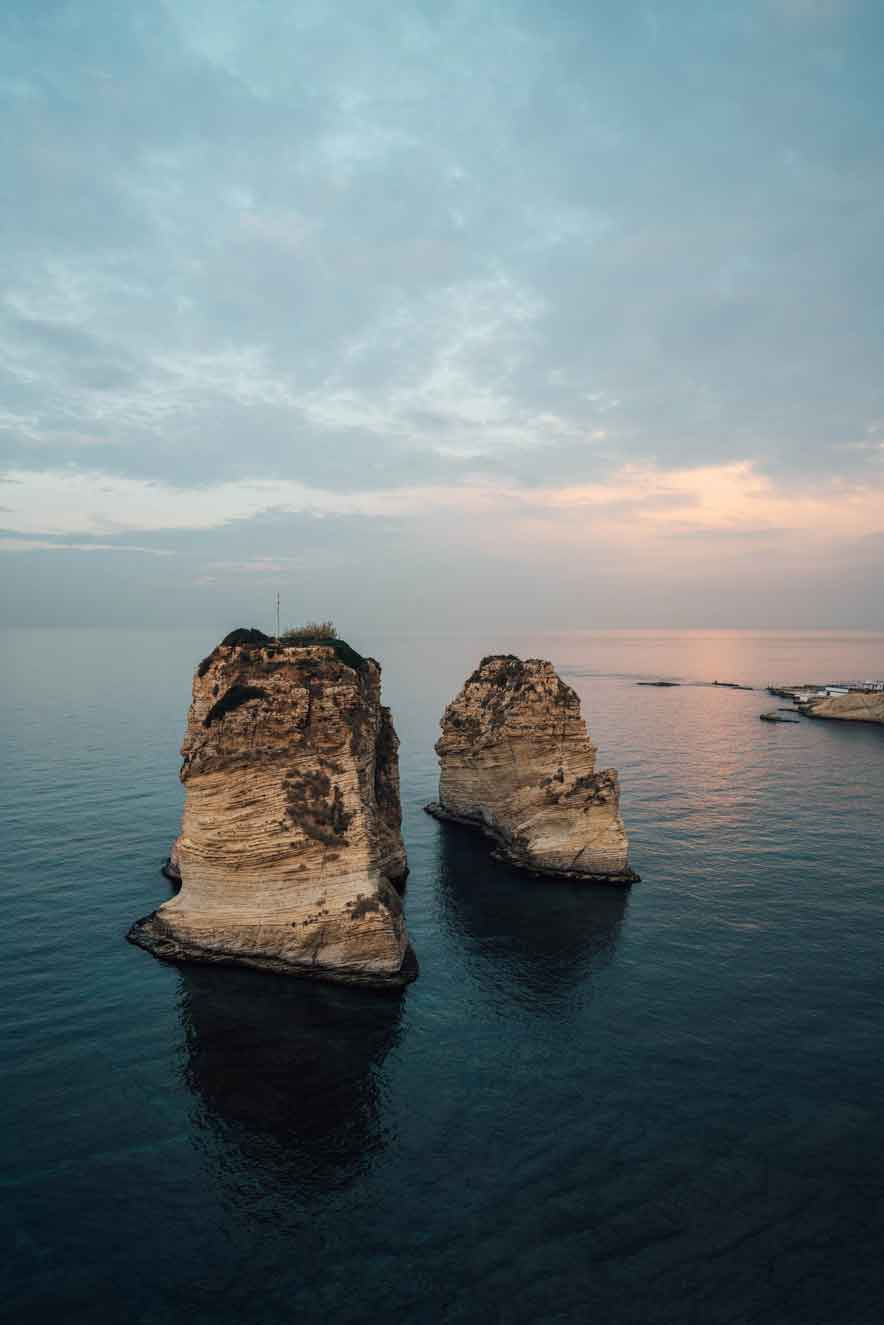 beautiful rock structures on the water in lebanon