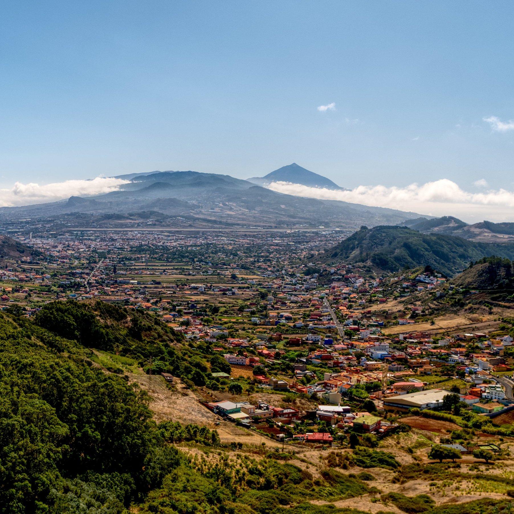 aerial photograph of city near mountain