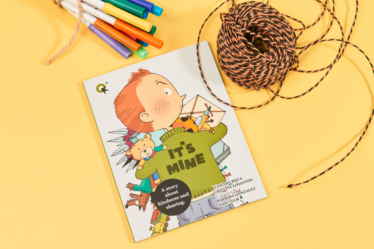 Cover of the book It's Mine by Quirky Kid with a boy in a green jumper hoarding various toys