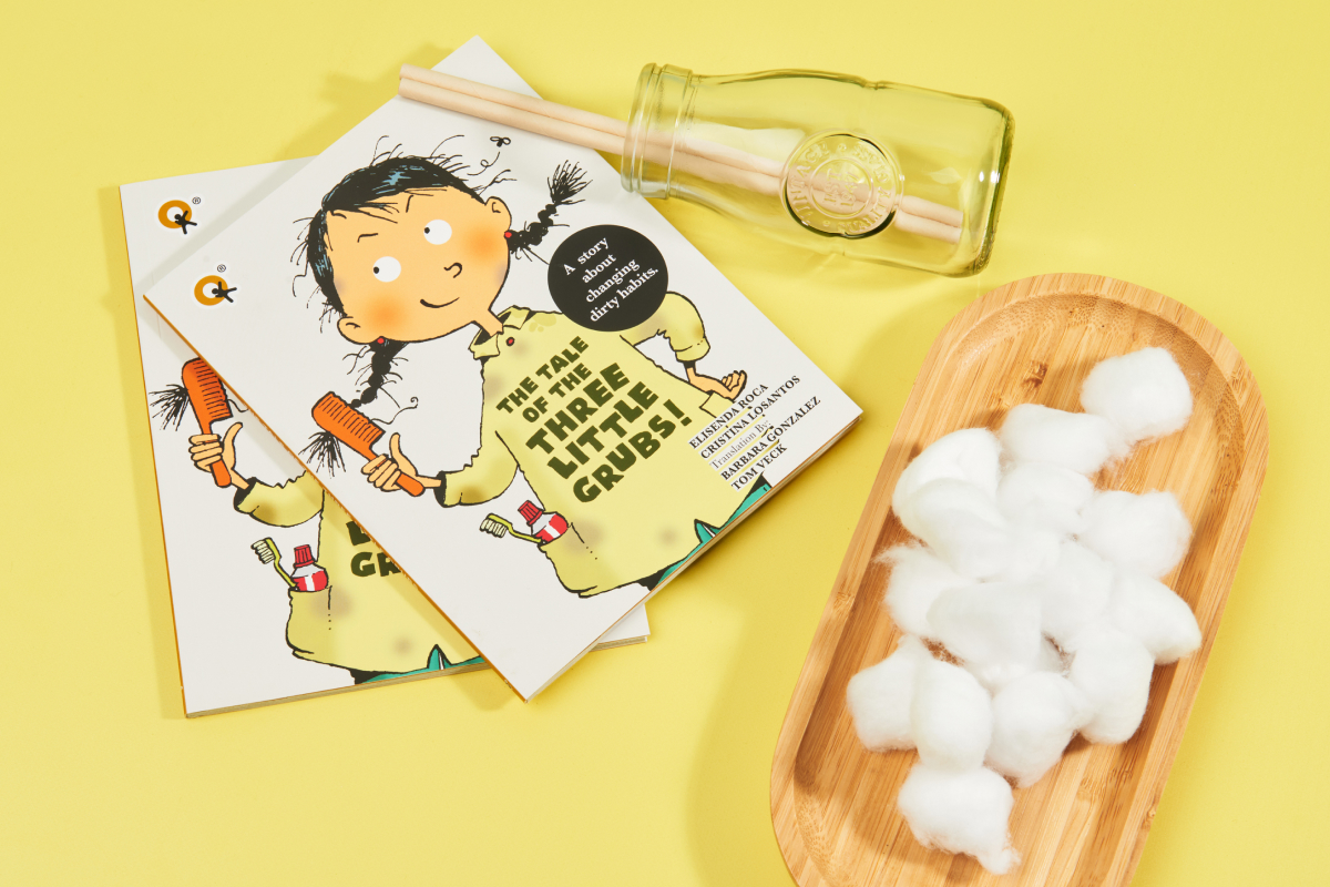 Cover of the Book The Tale of The Three Little Grubs with an illustration of a cute young girls on a dirty yellow shirt and a messy hair holding a brush