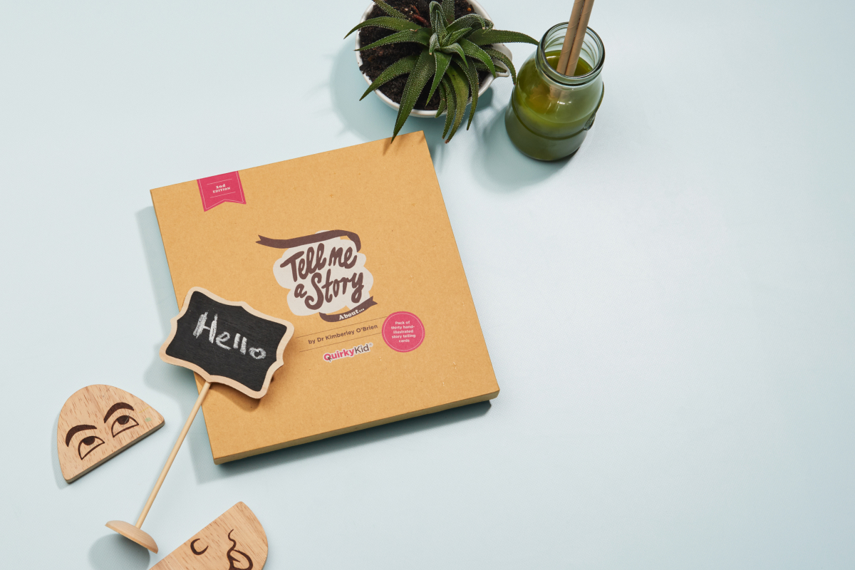 Photograph of the Tell me a Story cards including the product box and some cards with illustrated words such as The Luckiest you ever felt.