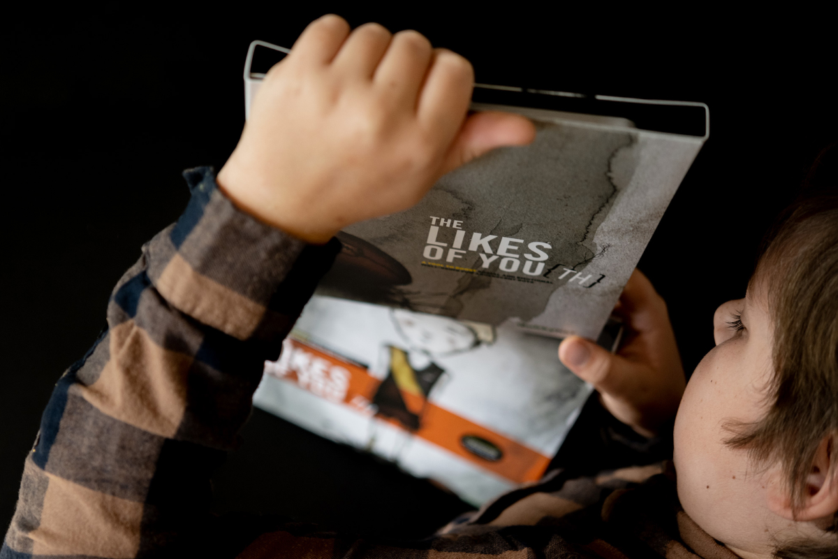 Product Photography of the LIkes of Youth Kit by Quirky Kid showing a boy unpacking the cards