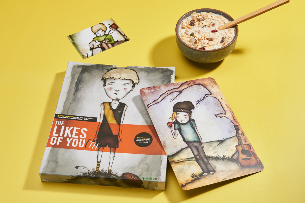 Product Photography of the LIkes of Youth Kit by Quirky Kid showing a box and some flash cards next to a plate of cereal