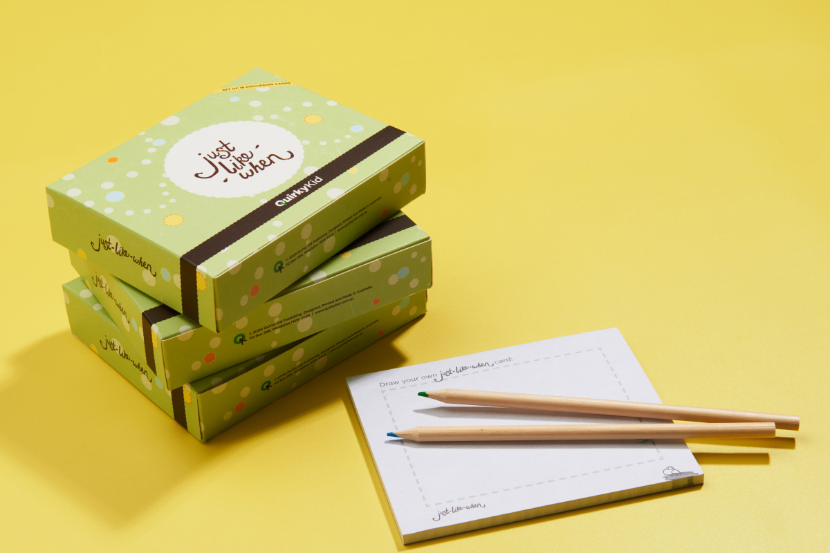 Product Photography of the Just Like When Cards by Quirky Kid showing the box next to a note pad and pencils