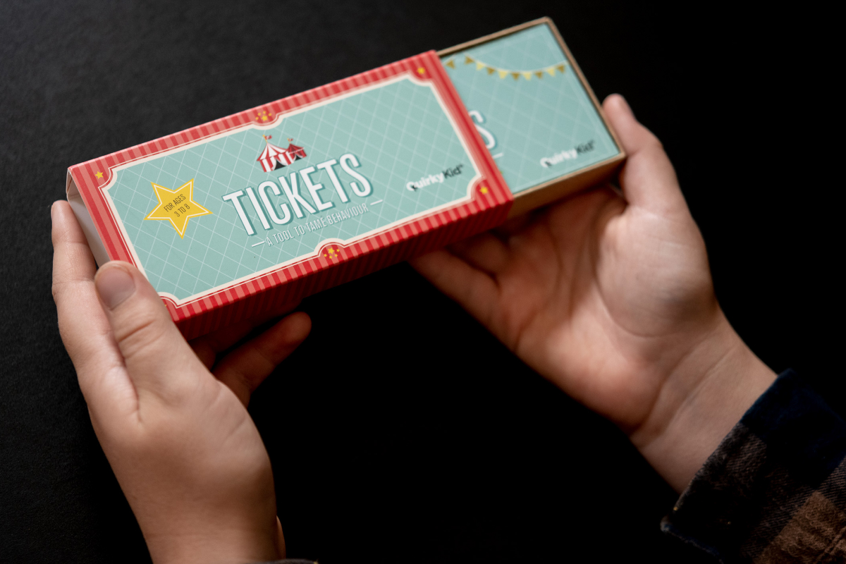 Product Photography of the Tickets by Quirky Kid showing  two zoon in hands opening the box of tickets