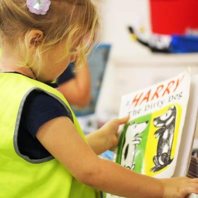 Toddler picking a book