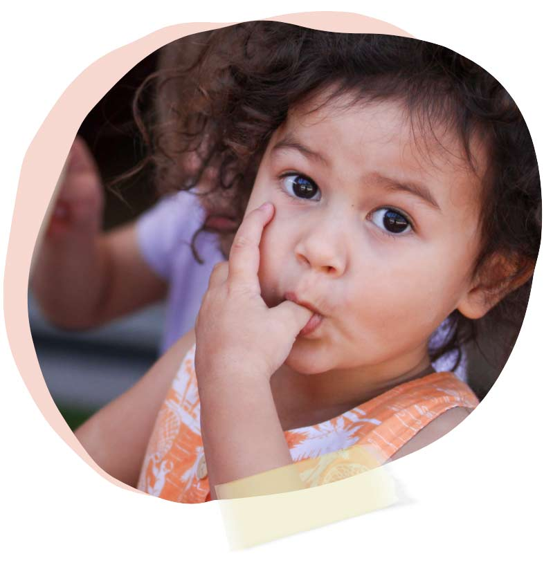 young child eating lunch
