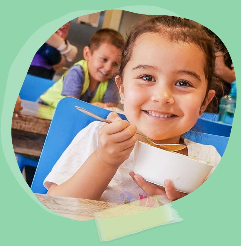 Child meal and smiling at Atlantis Early Learning