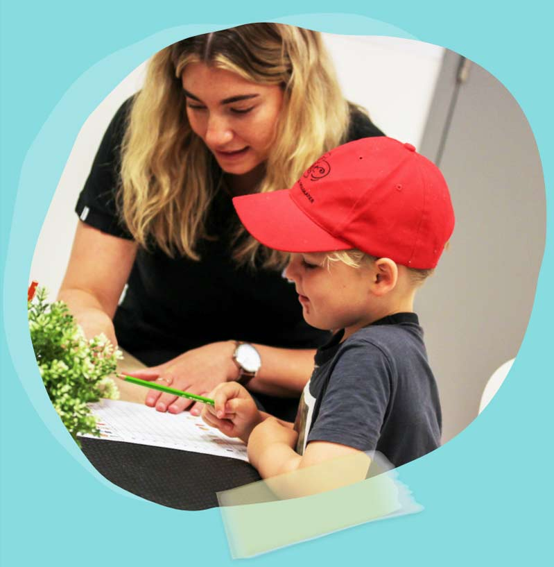 Educator reading with child at Atlantis Early Learning