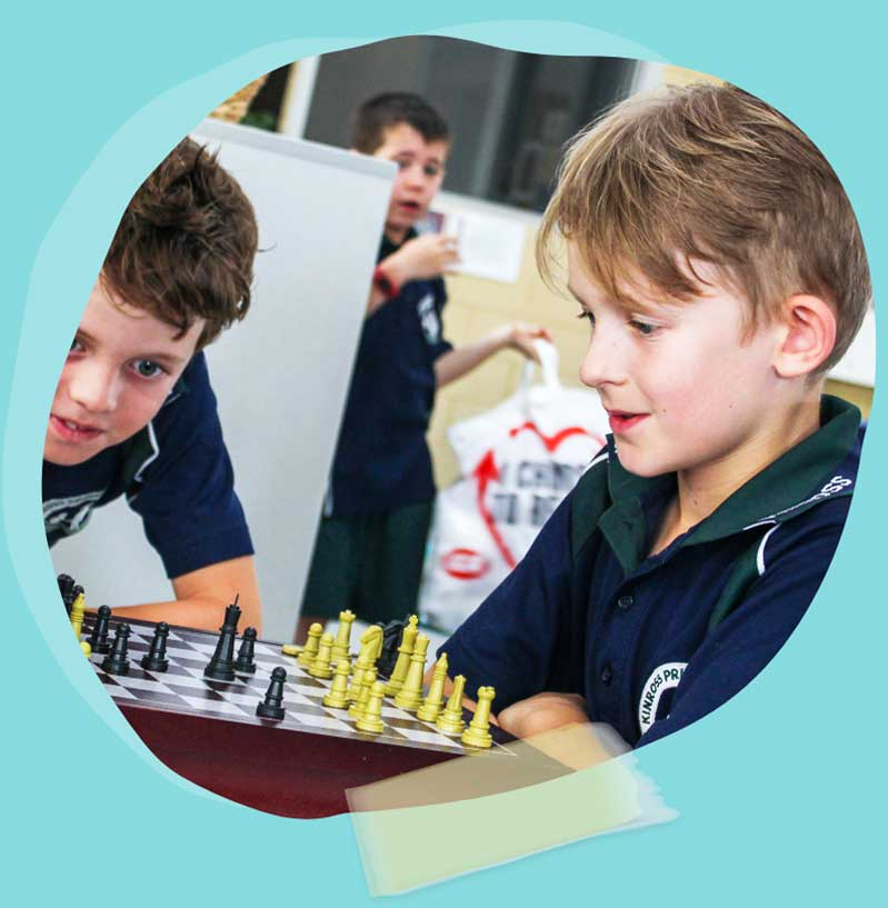 Young boys playing chess after school