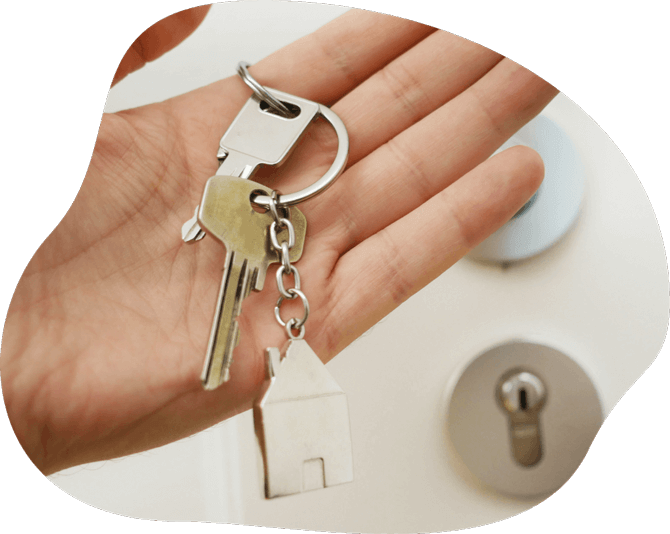 Image of a hand holding house keys