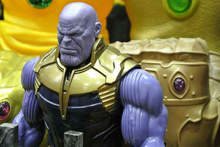 Thanos figure with plastic gloves behind