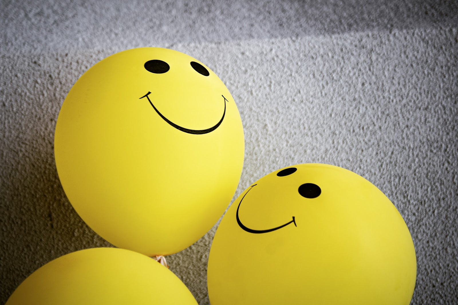yellow balloons with smiley faces.