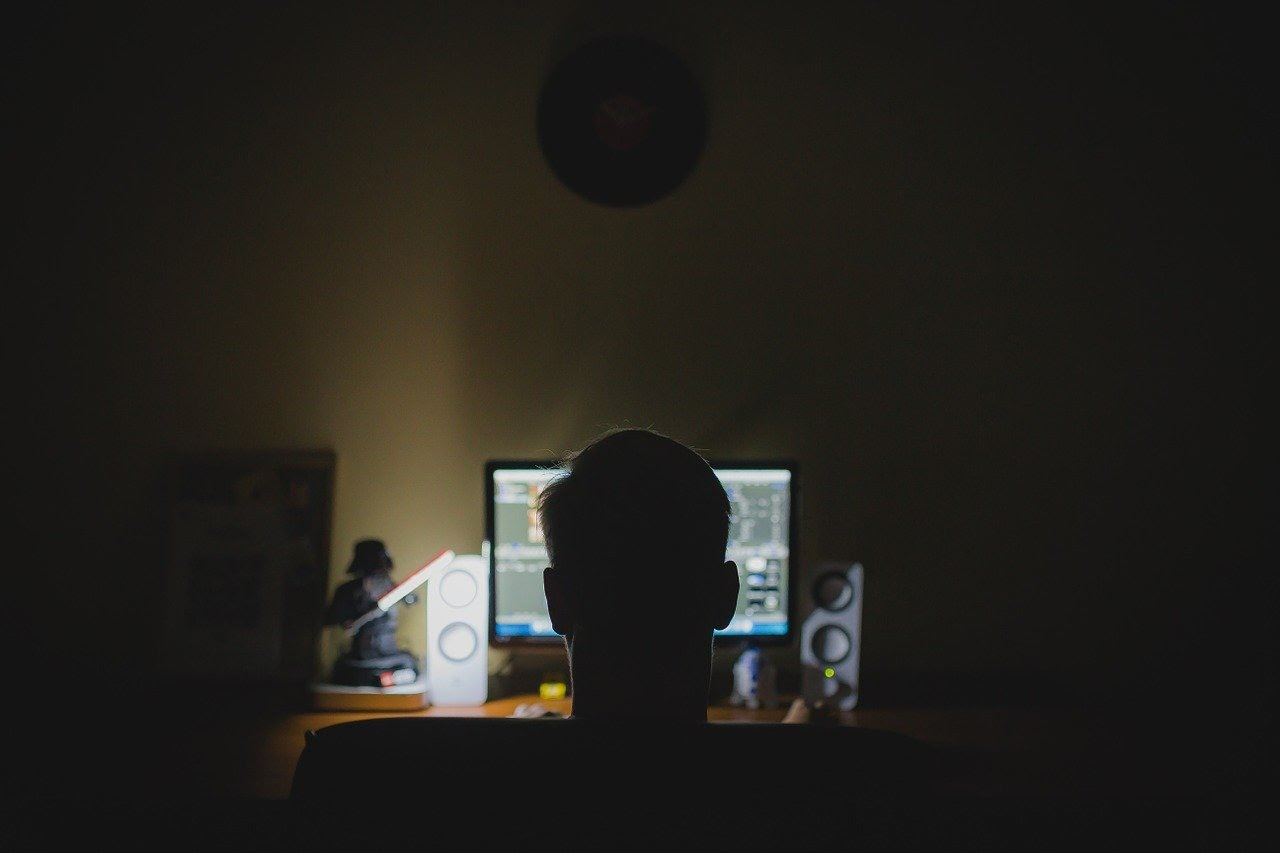 Person watching a computer late at night