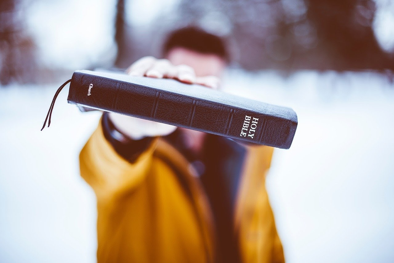 Man holding the Holy Bible