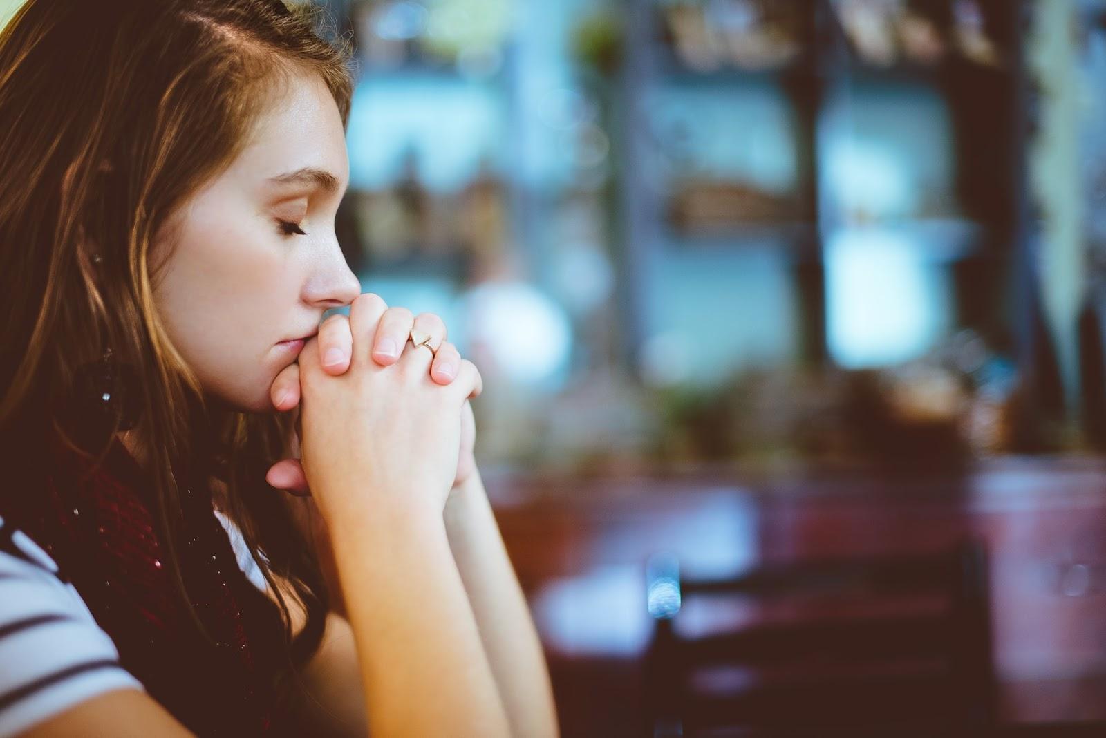 a woman praying