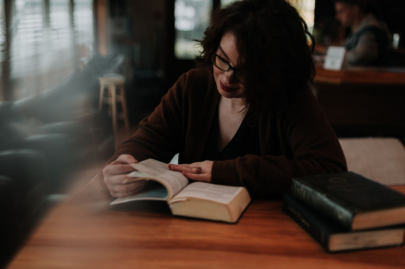 Woman reading scriptures in a cafe