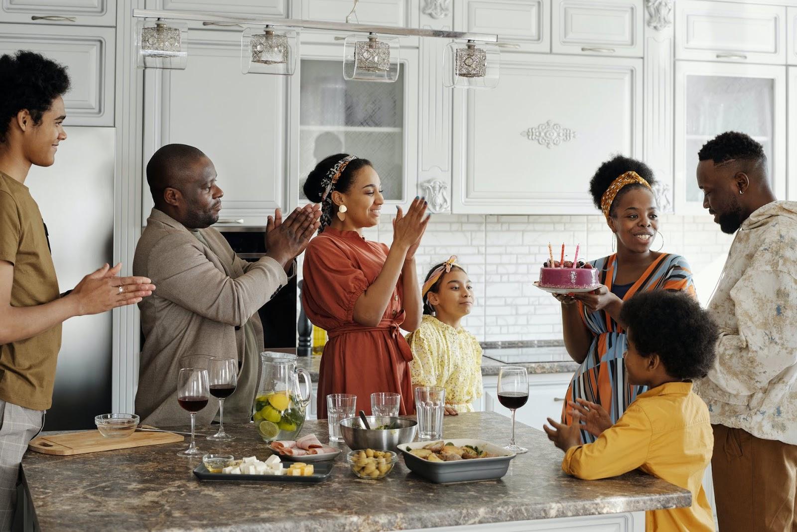 Family gathered around food to celebrate birthday
